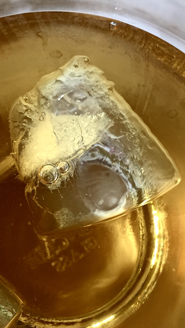 an ice cube floating in Four Roses whiskey