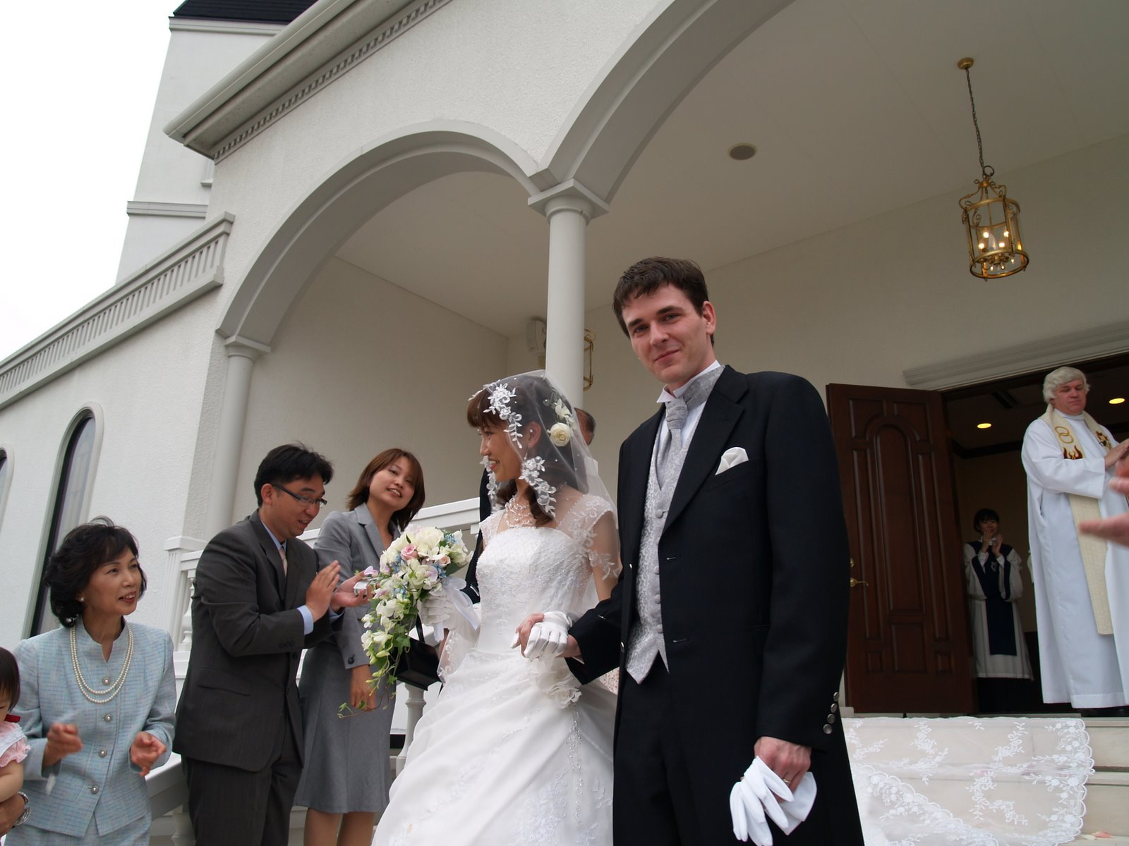 Reiko and Jason Irwin, Walking Down the Steps of the Chapel