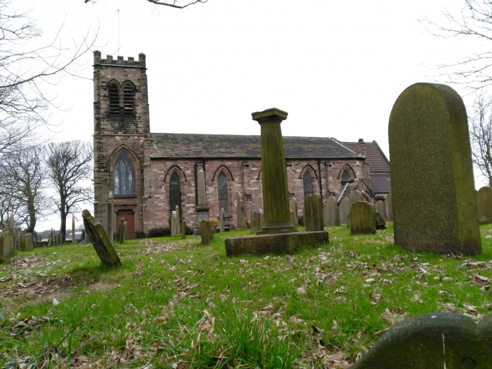 Melling church from churchyard with sundial.jpg